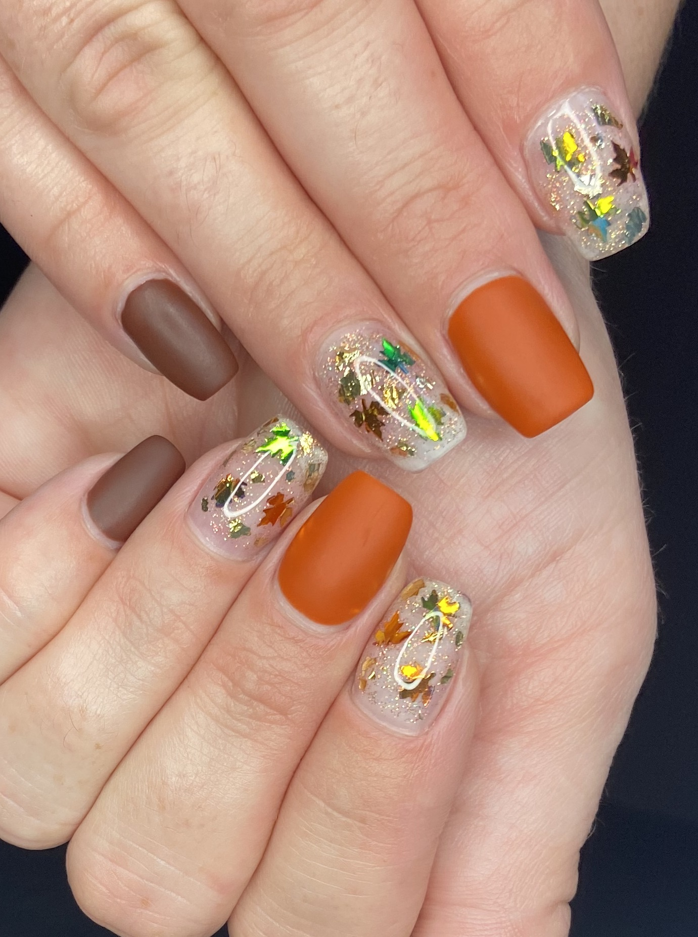 Autumn Leaves and Glitter Nail Design